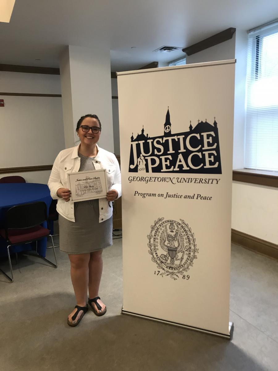 Elena Itameri smiling with her certificate